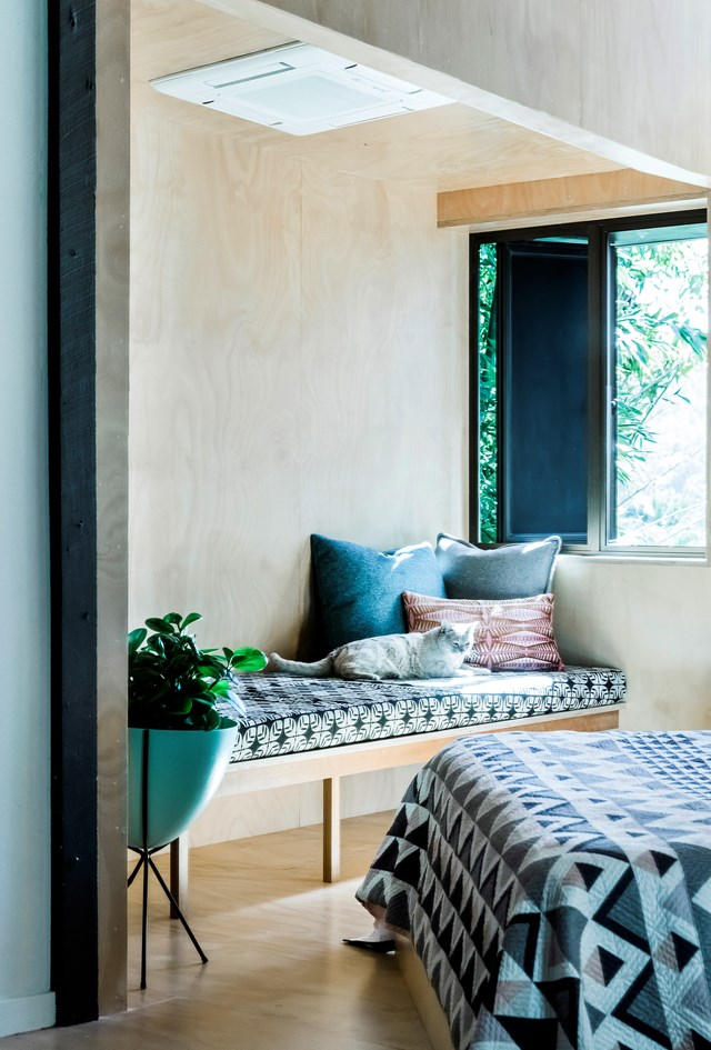 """An inviting window seat in the bedroom of this [modernist timber home in Brisbane](https://www.homestolove.com.au/renovation-of-modern-timber-home-6564