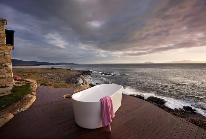 """**[Swansea, Tasmania](https://www.airbnb.com.au/rooms/2022526?s=sFboY-Af&sug=50 target=""""_blank"""")** <br><br> This unique oceanfront retreat is set on a private 120-acre wooded peninsula with views of crystal-blue waters. It can fit up to eight guests and is equipped with four bedrooms and four bathrooms. Plus, that outdoor bath tub looks like heaven.  <br><br> Price: from $800 per night."""