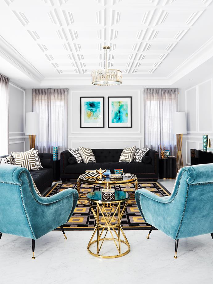 In the informal living room, 'Giardino' Cameron chairs, Eichholtz sofas, 'Holmes' lamps, 'Padova' coffee table and 'Domingo' side table, all from James Said. Greg Natale rug from Designer Rugs. Cushions from Greg Natale. Afternoon Sky and Summer Shower artworks by Designer Boys.