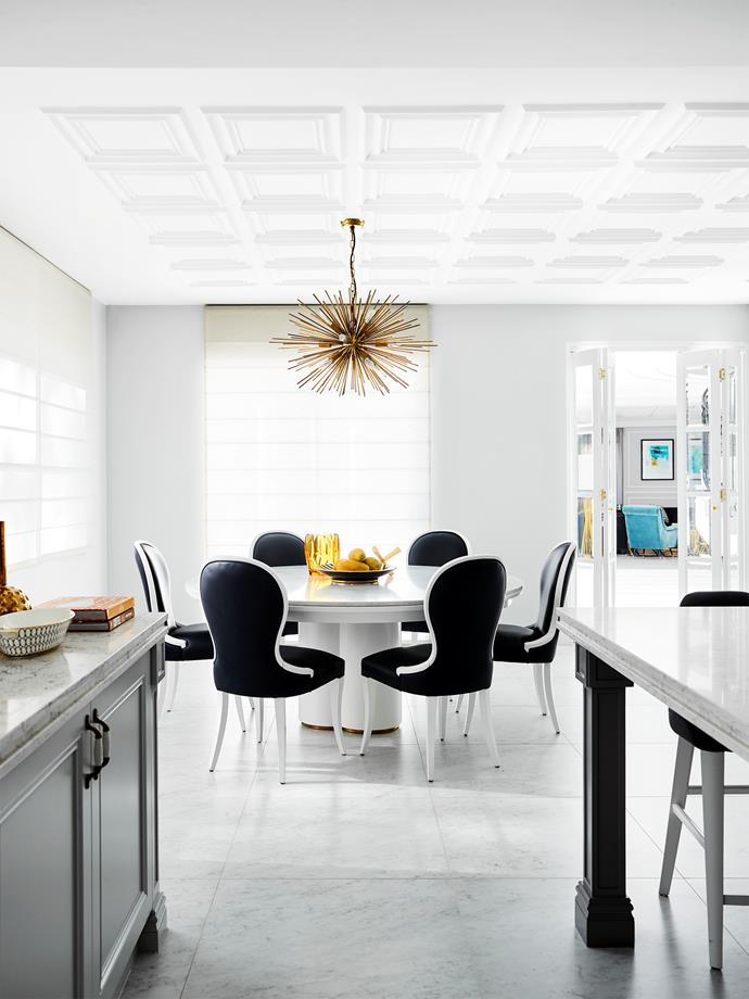'Ella' chairs from Casa Mia. 'Hudson' table from Greg Natale. Eichholtz 'Boivin' pendant from James Said.