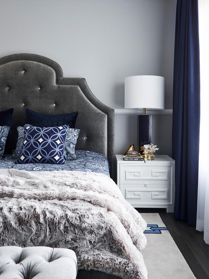 Jonathan Adler 'Woodhouse' bed from Coco Republic. 'Hudson' bedside table and cushions from Greg Natale. Worlds Away 'Harper' lamp from James Said.