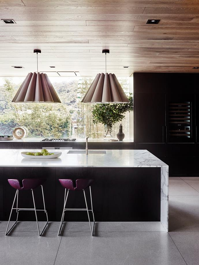 Benchtop/island bench: Arabescato Vagli marble on island, and cooktop surface in etched stainless steel, both from CDK Stone. Weplight 'Lora' wood veneer pendants from ECC Lighting+Furniture.  *Photo: Anson Smart*