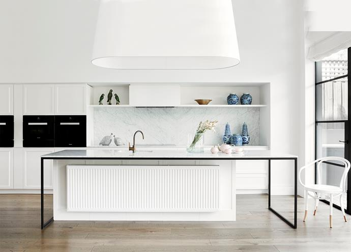 Joinery: Dulux 'Natural White' satin two-pack finish from Emerald Shopfitters. Benchtop/island bench/splashback/wall finish: Honed Carrara marble from CDK Stone. Flooring: Engineered oak 190x15mm floorboards in Chestnut from Profile Timber Floors. *Photo: Christine Francis*