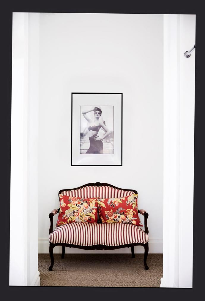 Photographs by some of Lizzie's favourite fashion photographers deck the halls, along with a loveseat that belonged to her grandmother.