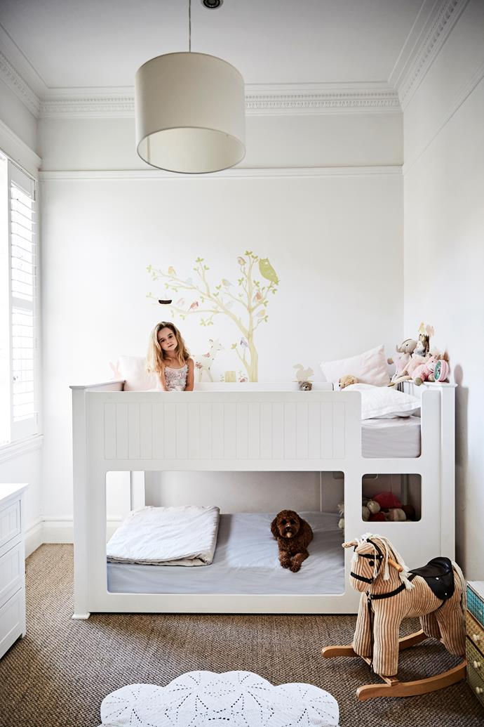 Luella (wearing a Tutu Du Monde dress) and Max share a room, which has been set up with Domino bunks, sisal carpets in a kid-friendly dark shade and a rocking horse from Kidstuff.