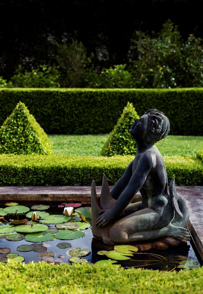 "'Boy on a Dolphin' bronze fountain is Margaret's favourite element. The pond is filled with [water lilies](https://www.homestolove.com.au/how-to-grow-water-lilies-9991|target=""_blank"")."