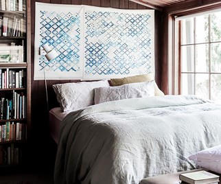 Bedroom in a renovated 1890s timber cottage