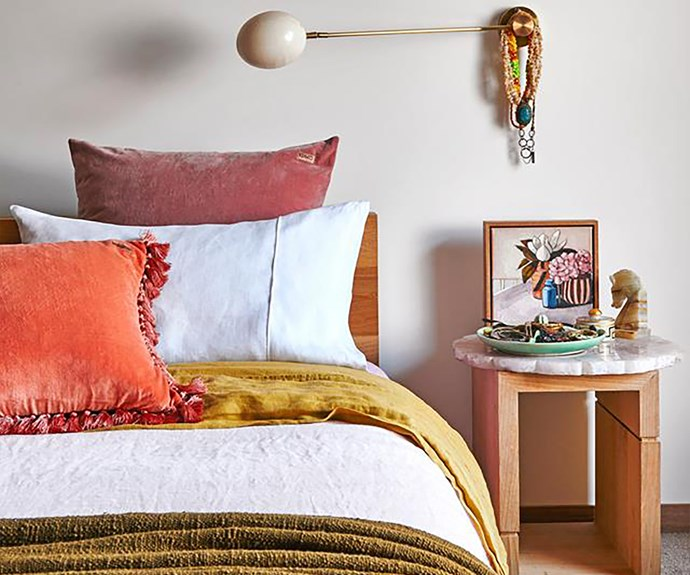 Bed with burnt orange and mustard accessories