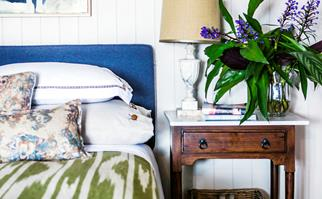 Bedroom styled with antique side table