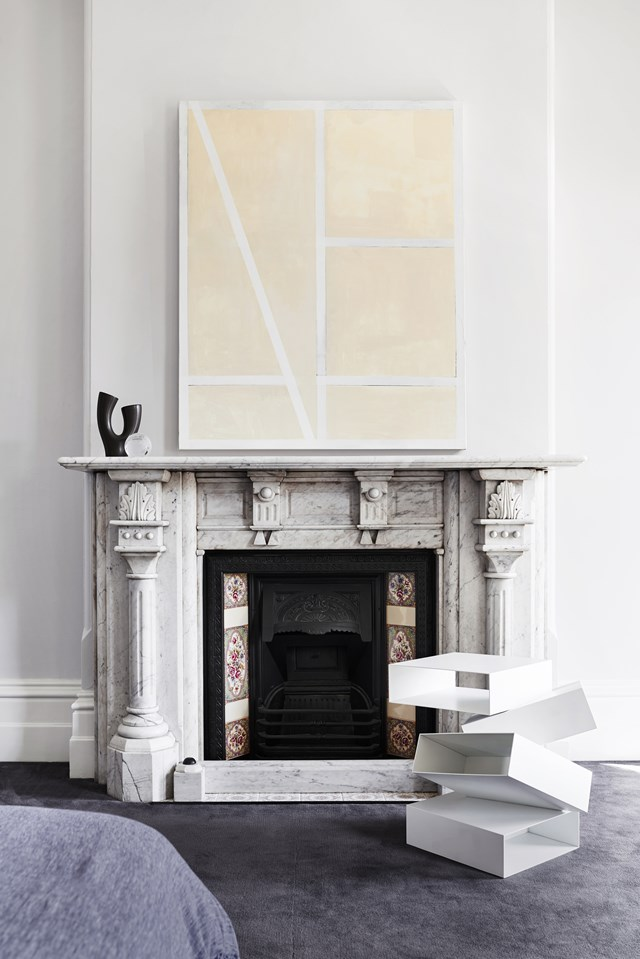 """A grand marble fireplace in a [renovated Victorian terrace](https://www.homestolove.com.au/a-victorian-terrace-gets-a-contemporary-revamp-6624