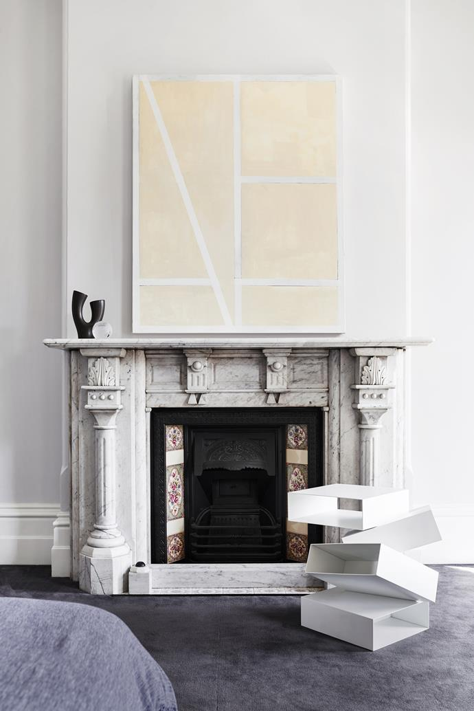 An artwork by Antonia Sellbach hangs above a grand fireplace.