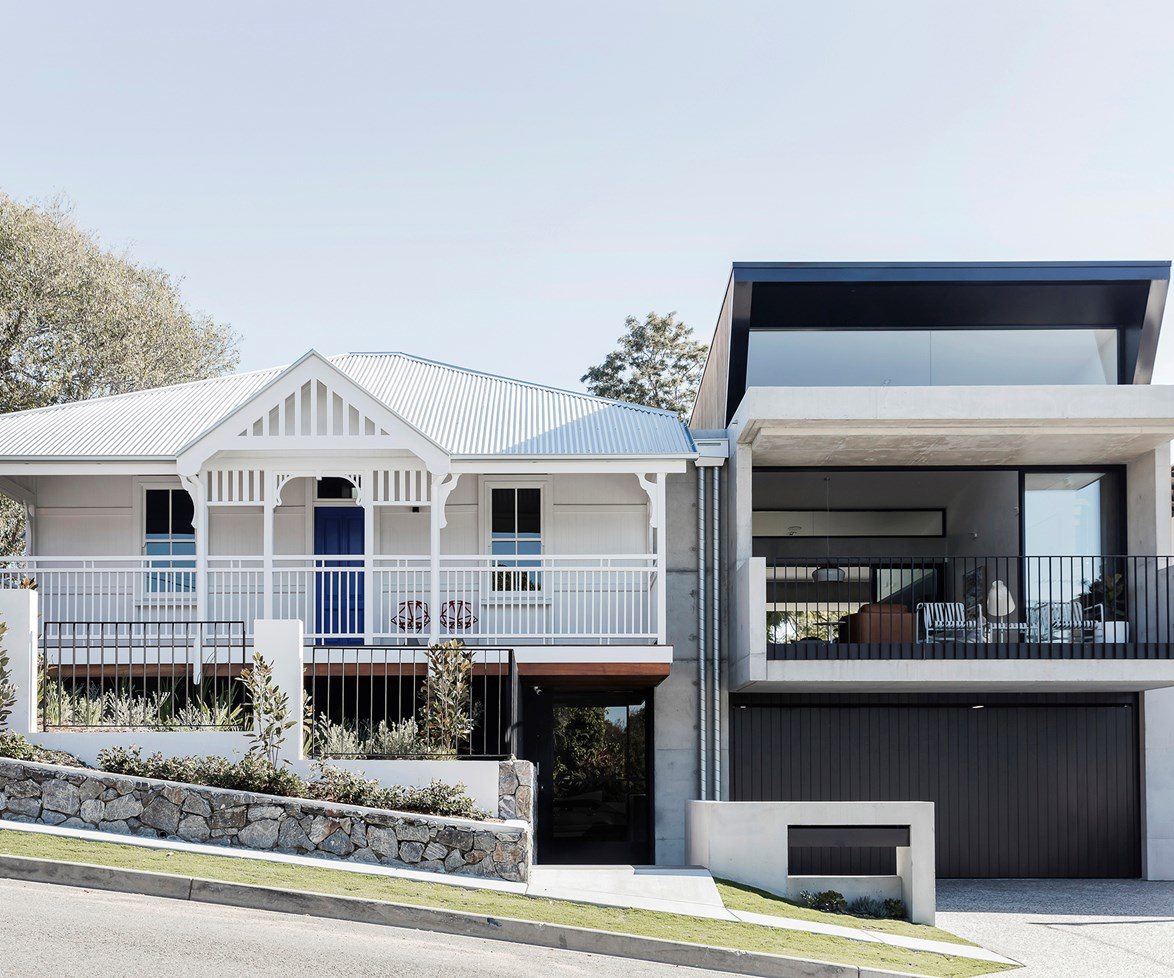 "After buying up the 1930s worker's cottage next door, this Brisbane couple decided to [refurbish the cottage and add on a modern extension](https://www.homestolove.com.au/an-old-workers-cottage-with-a-modern-extension-6627|target=""_blank""), creating a juxtaposing yet intriguing façade that allows them to enjoy the old with the new. Photo: Maree Homer / *Australian House & Garden*"