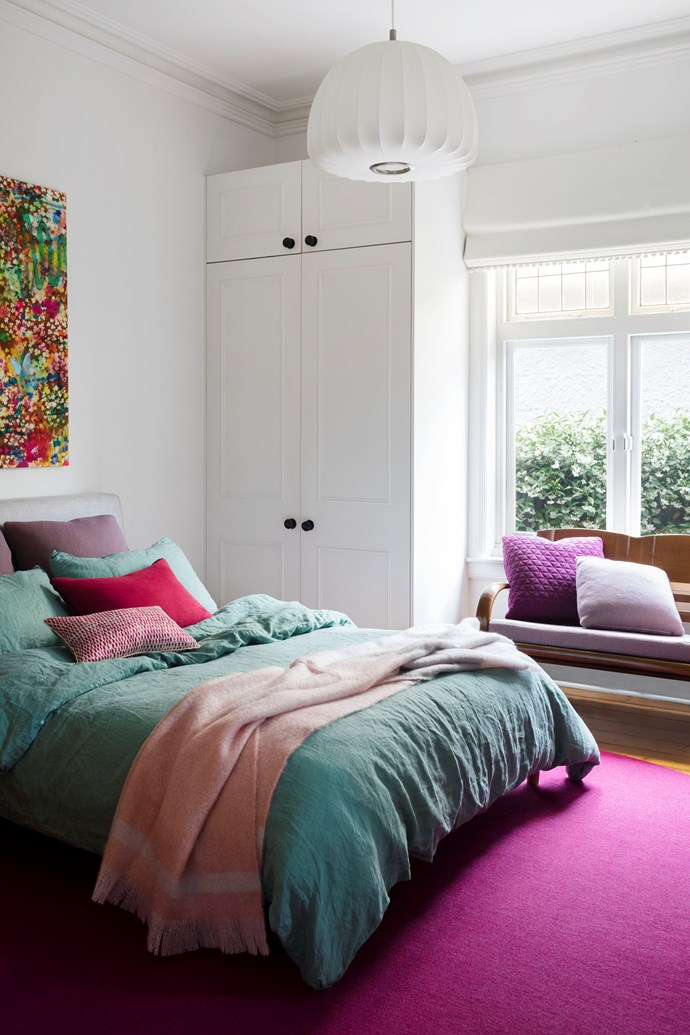 The second bedroom is decorated with a strong, yet feminine, colour scheme derived from the shades used in the artwork hanging above the bed.