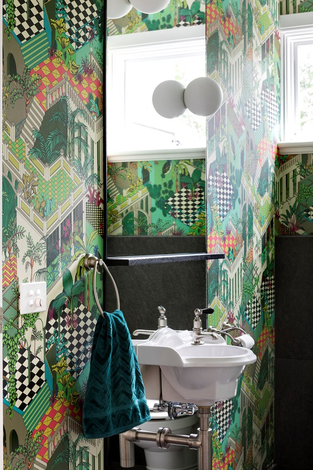 "Patterned green wallpaper adds energy to this small powder room in a [vibrantly renovated weatherboard home](https://www.homestolove.com.au/a-vibrant-renovation-of-a-weatherboard-home-in-melbourne-6631|target=""_blank"") in Melbourne. *Story: Australian House & Garden*"