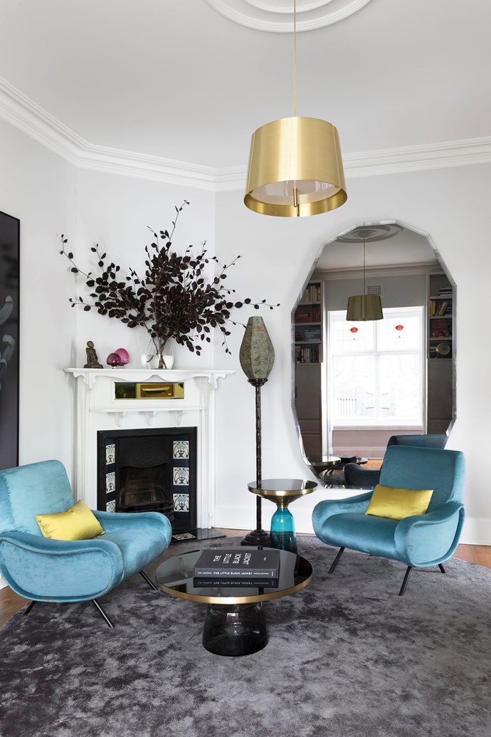 As well as having a desk, this room is a special place to receive visitors. Milly Bray designed both mirrors; the one above the fireplace works in with the room's brass touches.