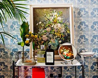 Mirror, artwork and trinkets on top of a bathroom trolley