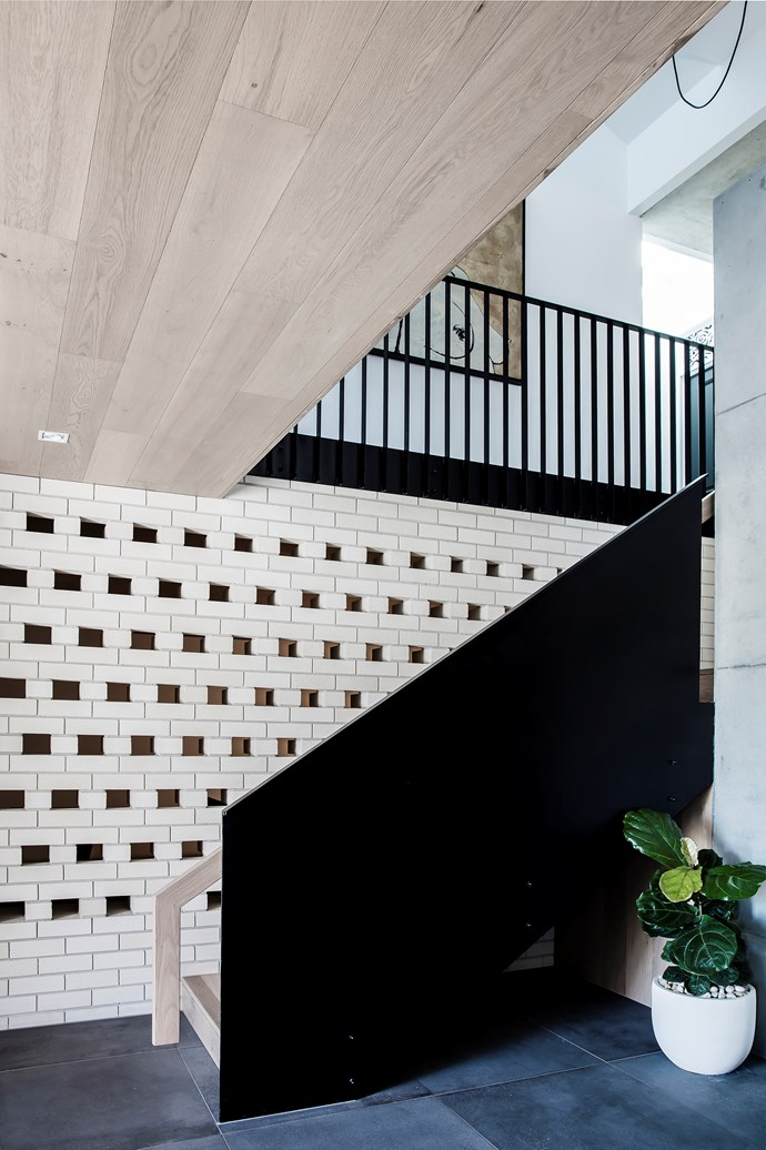 In the stairwell, bricks were laid in a pattern that is decorative and ensures good ventilation. 'Bowral' bricks in Chillingham White from Austral Bricks.