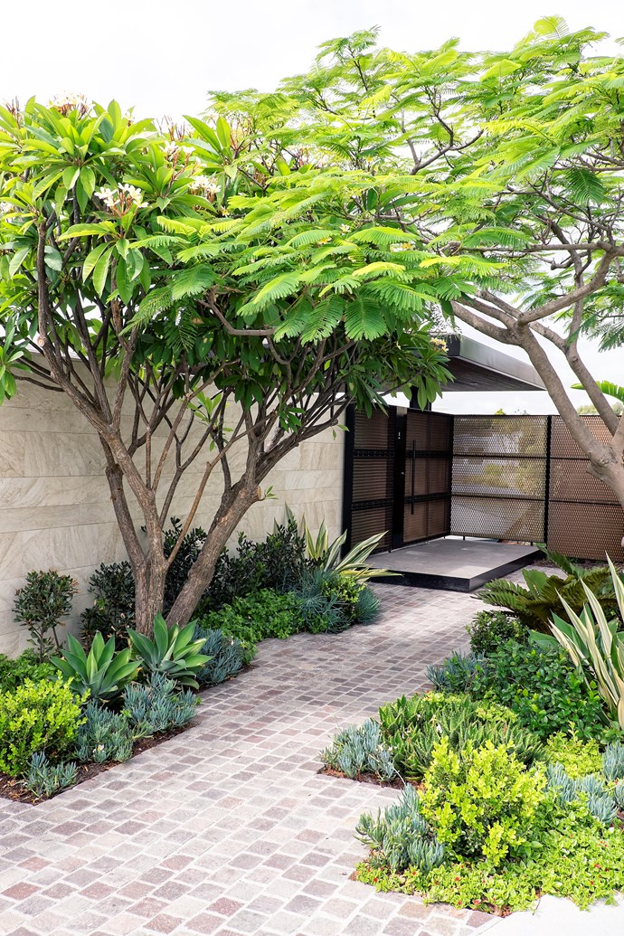 Get creative with the council verge to make a grant home entrance. *Photo: Grabb Photography*