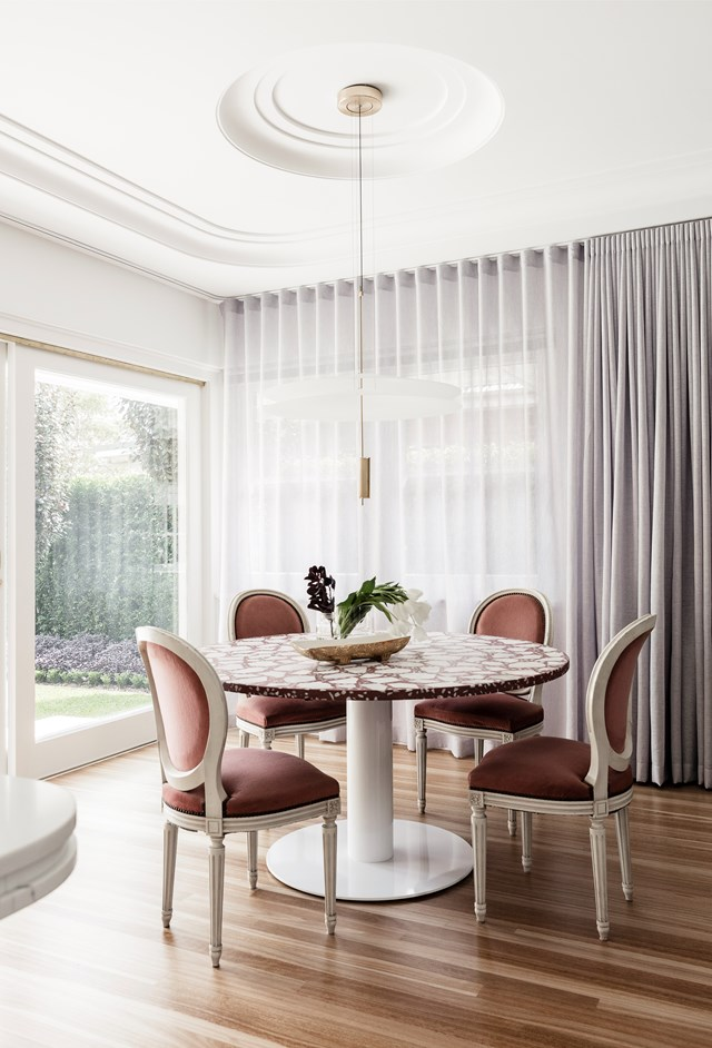 "Sleek, curved cornices in this dining room pay homage to the [art deco history of this renovated Newcastle home](https://www.homestolove.com.au/art-deco-style-honoured-in-renovation-of-newcastle-home-6661|target=""_blank""). *Photo: Maree Homer*"