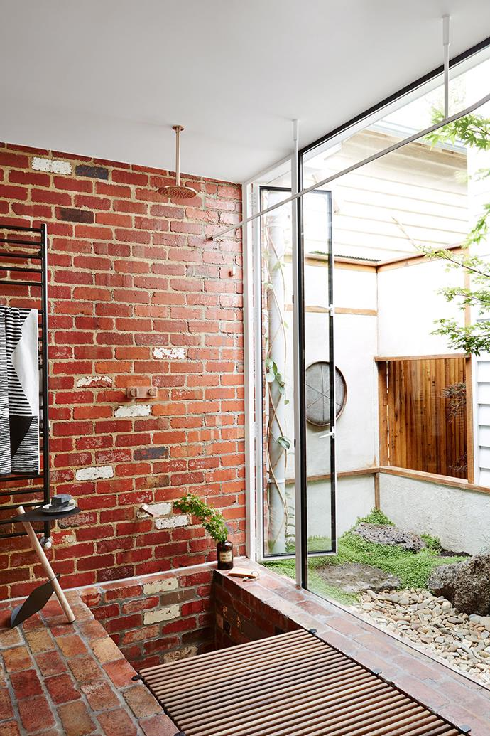 **Strip back.** Feature walls are tricky to get right in bathrooms and can quickly date. Exposed brickwork, on the other hand, is a striking option that only looks better with age. This brick-red wall gives a nod to the rich tones of the Australian landscape while injecting some much-needed warmth in to an exposed space.  <br><br> *Photography: Annette O'Brien bauersyndication.com.au*