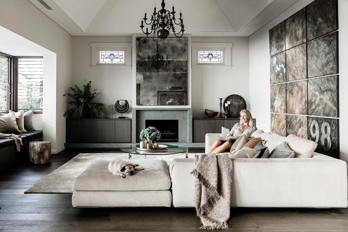 Owner Cheryl O'Neill and Winston the pug in a revamped space where notable features range from original 1920s stained glass and a vintage chandelier to tribal pieces and an Italian designer sofa.