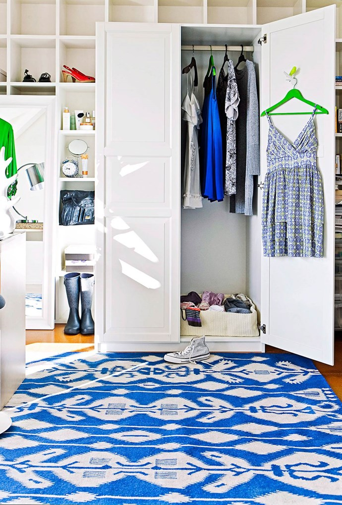 Give an all-white wardrobe a touch of personality with colour-pop hangers and a statement rug. Small open-shelved compartments allow you to display your favourite shoes and bags, and give you easy-access to everyday essentials. *Photo: Maree Homer / bauersyndication.com.au*