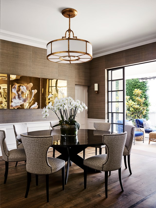 """Wallpaper above white wainscoting elevates [this dining room](https://www.homestolove.com.au/a-spanish-mission-style-homes-hollywood-glamour-update-6677