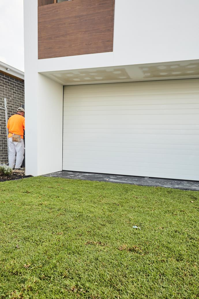 """**MAY 16, 2018: GRASS-CEL DRIVEWAY GOES IN** <br><br> My Ideal House is packed with innovative features - and one of the most impressive has to be its grass driveway, which is pictured here just minutes after its installation. So how is a lawn driveway even possible? It's all down to the durable [Grass-Cel](http://www.grasscel.com.au/