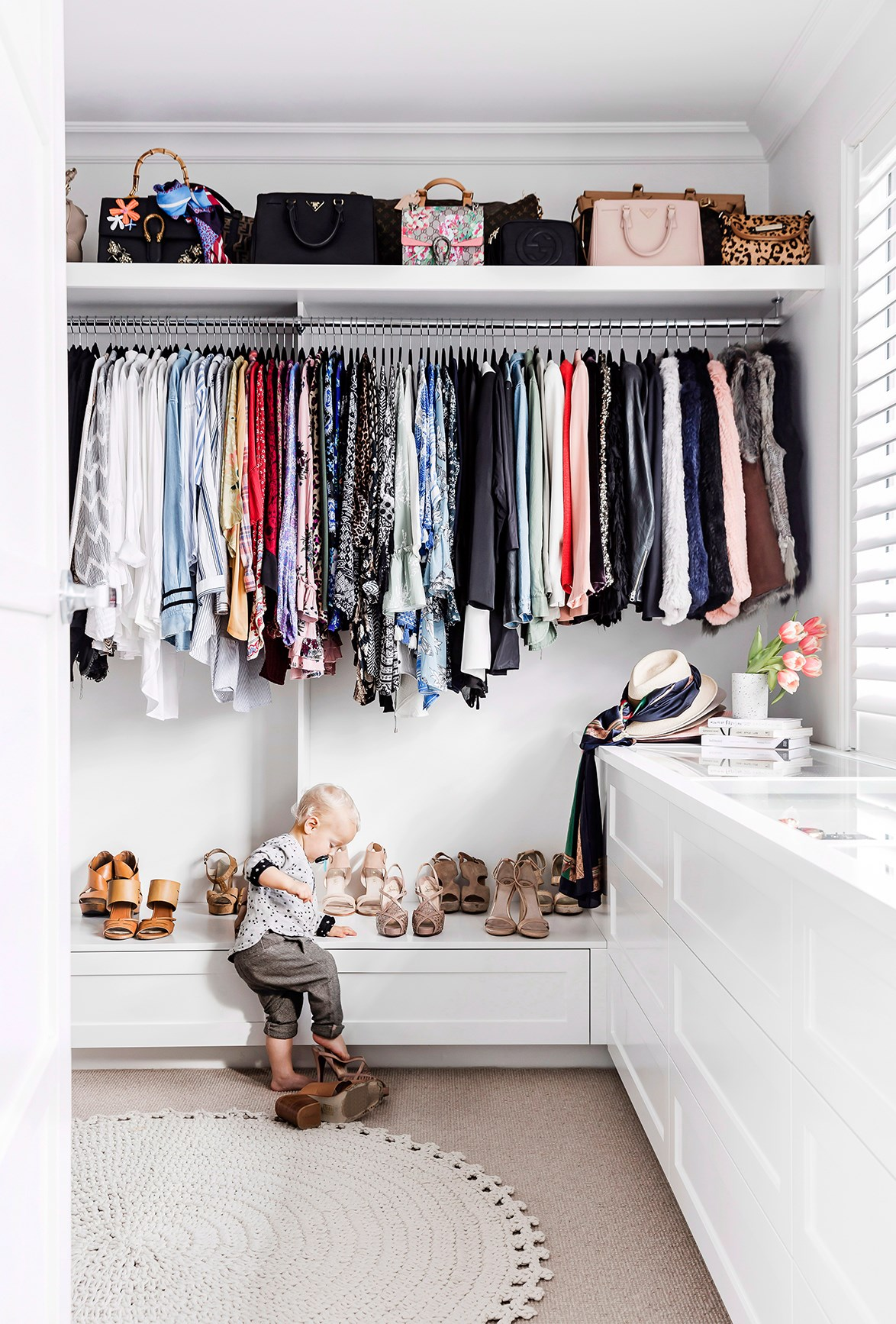 "Is your wardrobe quite literally bursting at the seams? Let this beautiful wardrobes inspire you to [organise your own](https://www.homestolove.com.au/how-to-organise-your-wardrobe-6984|target=""_blank""). You'll be amazed at how much time you save in the morning! *Photo:* Maree Homer / *bauersyndication.com.au*"