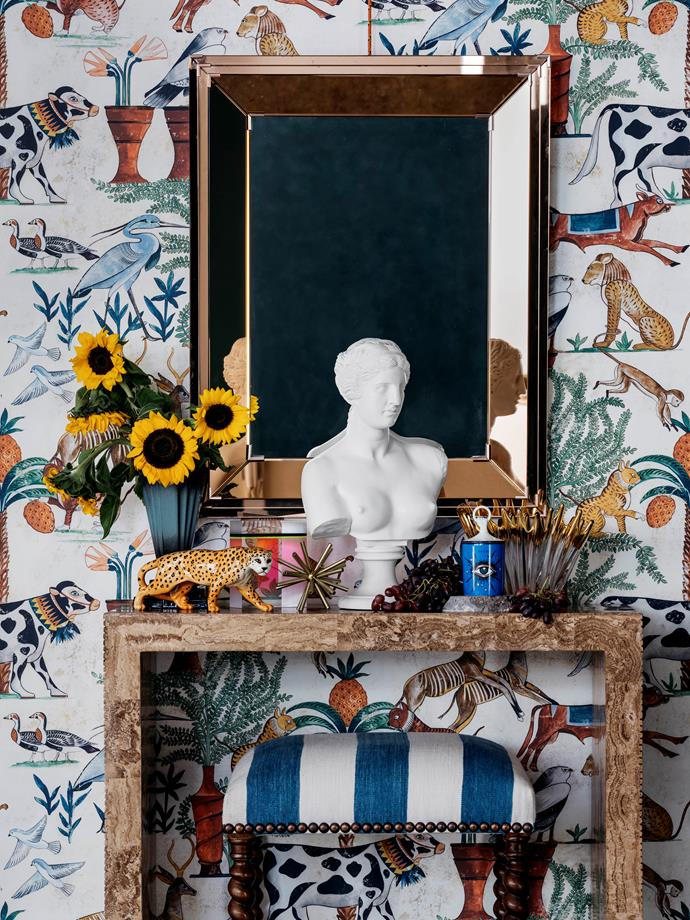 Pierre Frey 'Sur Le Nil' wallpaper, POA, from Milgate. Midcentury glass mirror, $5800, from Conley & Co. Console, $6800, from Conley & Co. Charles II-style stool, $2400/pair, from The Vault. On console, from left to right Beswick leopard, $280, from The Vault. Meteor sculpture, $520/set of 3, from James Said. Aphrodite alabaster bust, $1295, from Mercer and Lewis. Glass vase, $900, from Conley & Co.