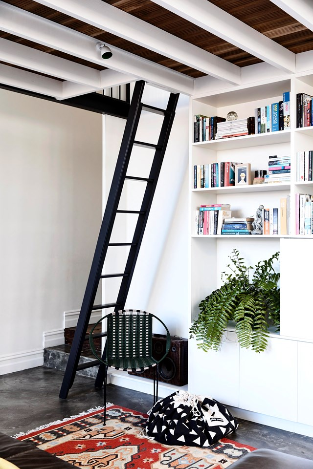 Cleverly positioned underneath a ladder to a mezzanine home office, this bookshelf provides oodles of extra storage as well as opportunity to display decorative items like indoor plants. *Photo:* Derek Swallwel