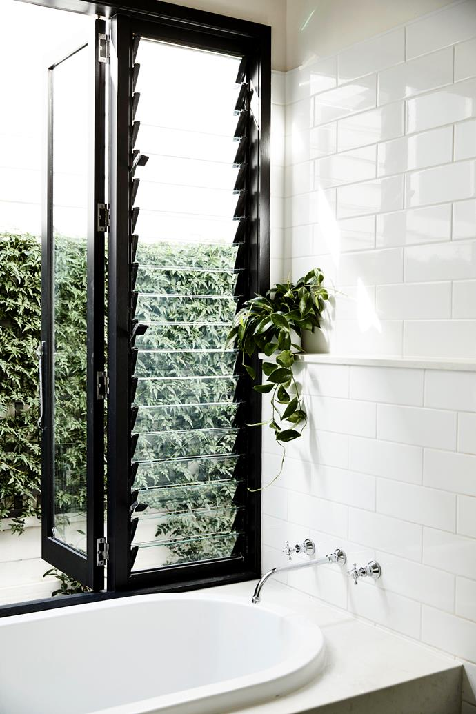 Louvred windows and fans circulate air efficiently throughout the house.