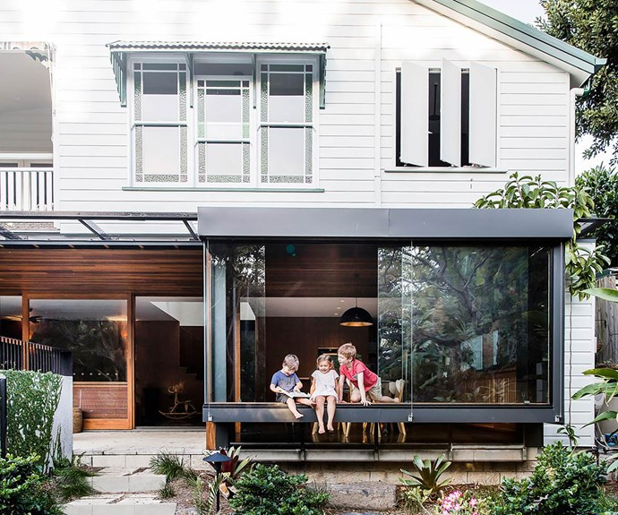 Queenslander style home with modern extension below top storey