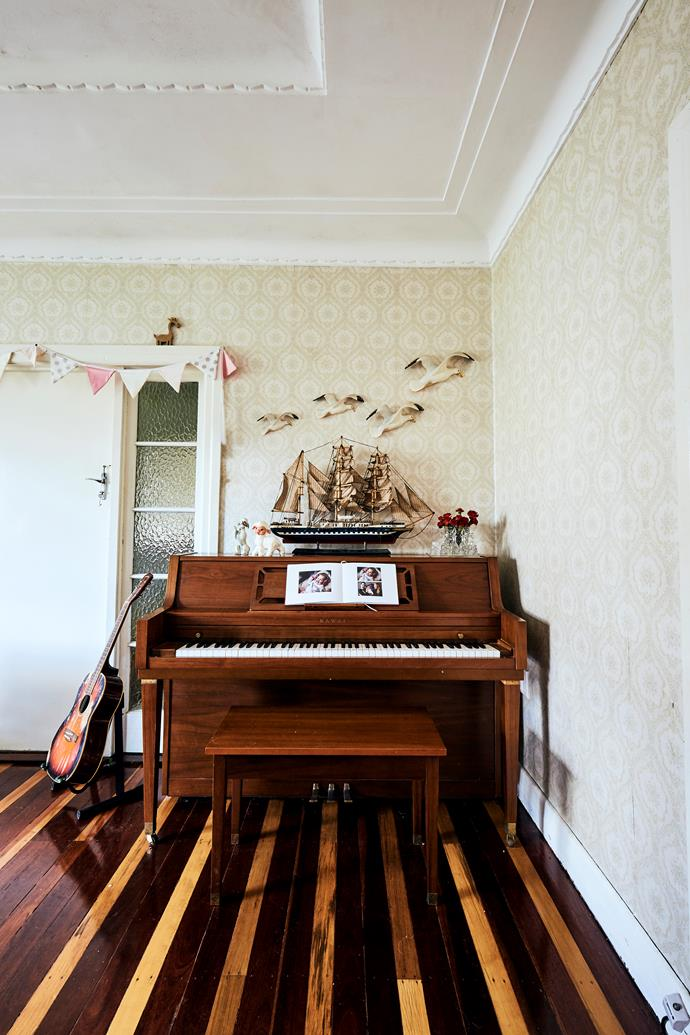 "A piano and flying seagulls that belonged to John's grandparents take pride of place in the living room. ""My style is sentimental-minimal,"" Patience says. ""Every decorative item in our home belongs to a memory and can service a story."""