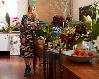 Saskia Hevekes at her home studio surrounded by floral arrangements