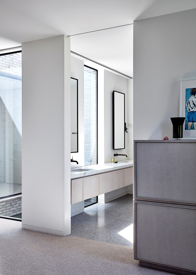 "Terrazzo's status as a divisive material stems in part from its use as a hero, or statement feature. In most cases, it is used to wow and capture attention. This bathroom in a [restored heritage home](https://www.homestolove.com.au/heritage-facade-with-modern-rear-extension-6724|target=""_blank"") shows that terrazzo really doesn't have to be divisive and can take on an almost neutral quality when paired with understated finishes. *Photo: Sean Fennessy / Story: Belle*"