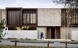 Modern style steel and brick home exterior