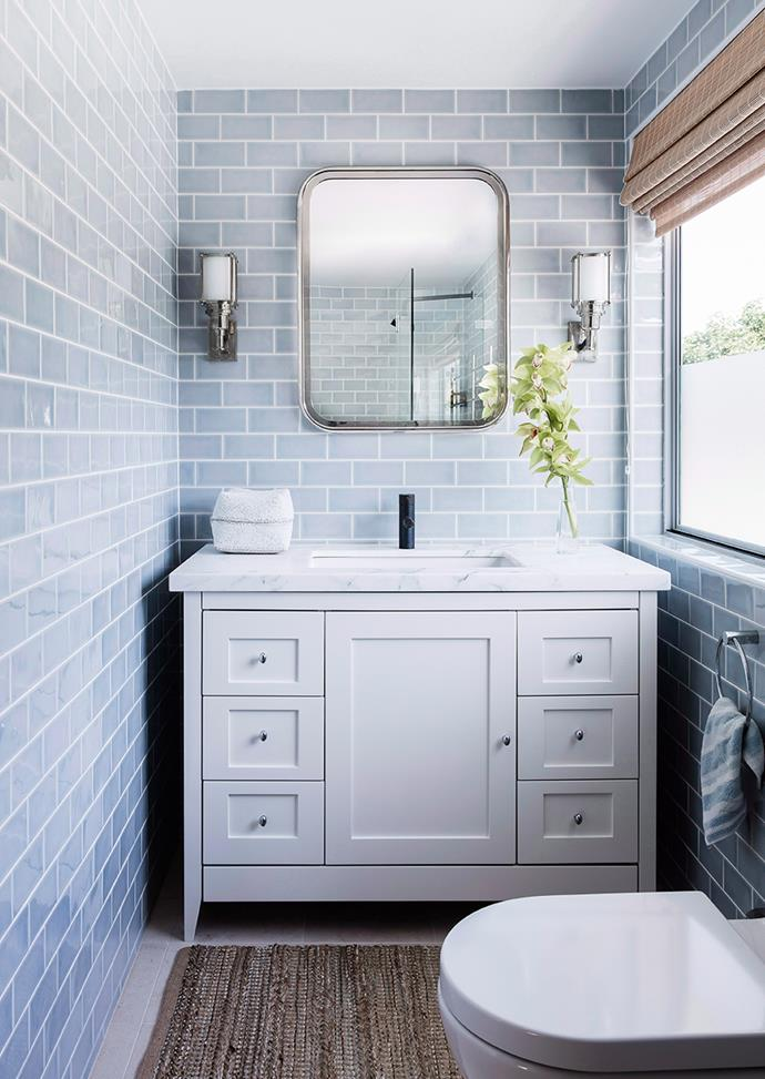Upbeat yet calming, pale blue tiles add a seaside-feel to this guest bathroom. *Photo: Maree Homer / Bauersyndication.com.au*