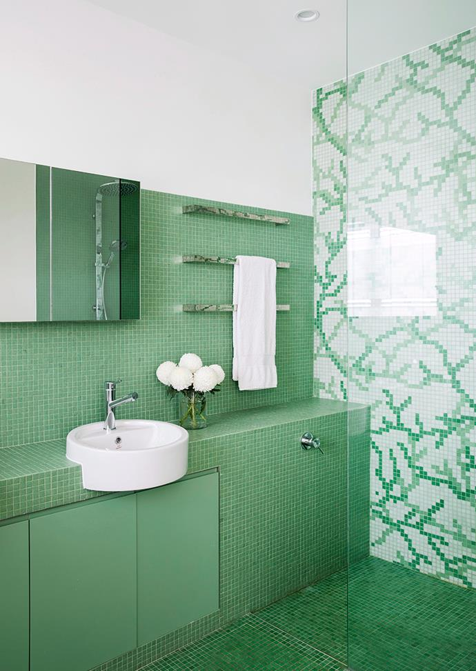 Make smaller bathrooms seem larger by infusing colours inspired by the outdoors. Light fern green tiles add warmth to this bathroom while white accents give it a chic and soothing finish. *Photo: Chris Warnes / Bauersyndication.com.au*