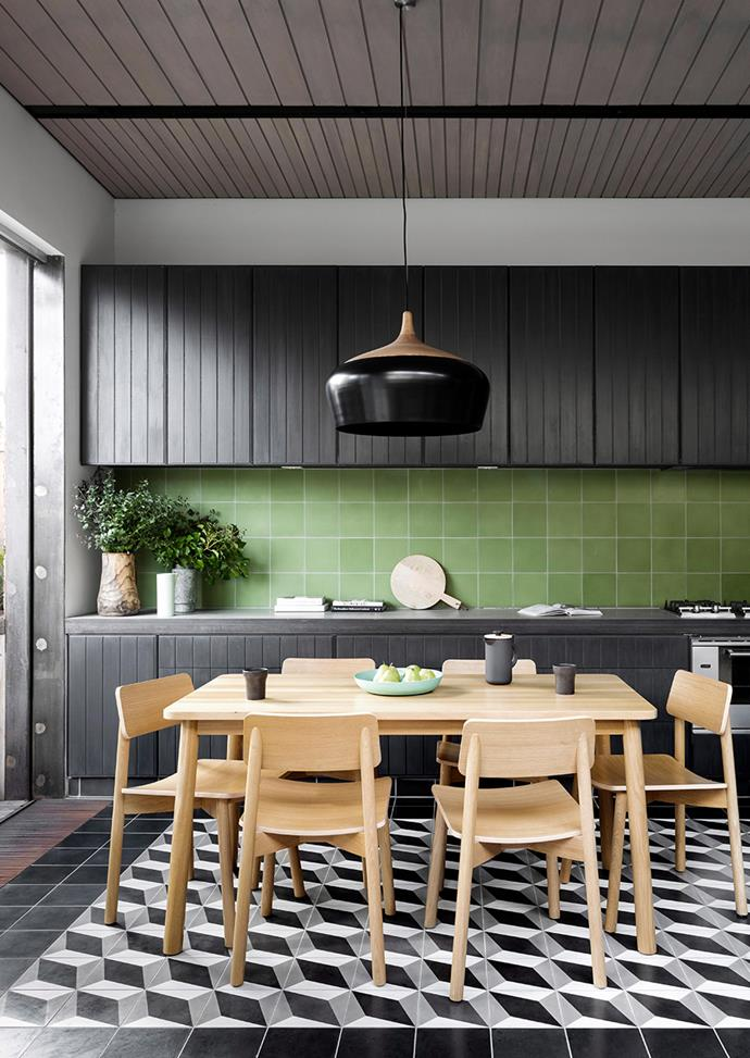 A green tiled splashback adds colour to this monochrome kitchen palette. *Photo: Martina Gemmola / Bauersyndication.com.au*