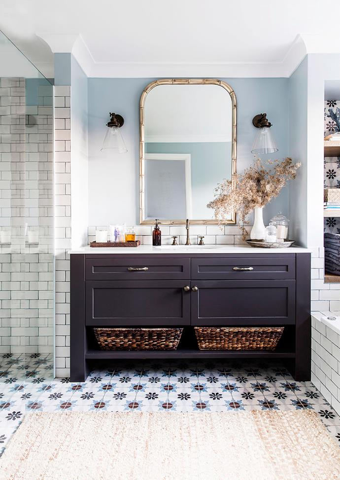 Pale blue walls and dark grouting complement decorative floor tiles, helping to bring out colour and prevent the space from looking busy. *Photo: Maree Homer / Bauersyndication.com.au*