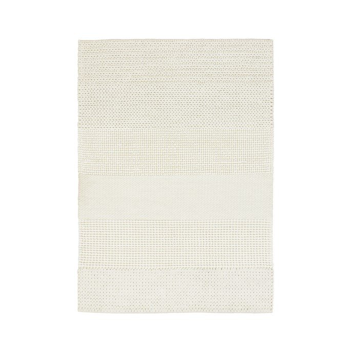 "Knitted **wool rug**, $699, from [Olli Ella](https://au.olliella.com/collections/rugs/products/knitted-rug|target=""_blank""
