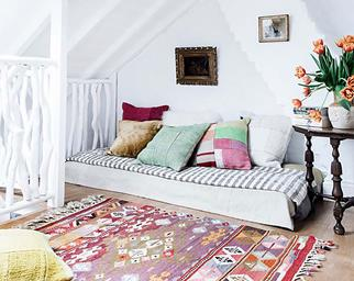 Pink sofa in a bohemian style living room