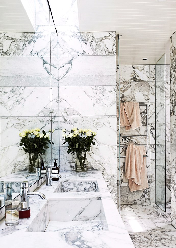 Using the same marble on walls and floor creates a seamless, more spacious bathroom. *Photo: James Greer / Bauersyndication.com.au*