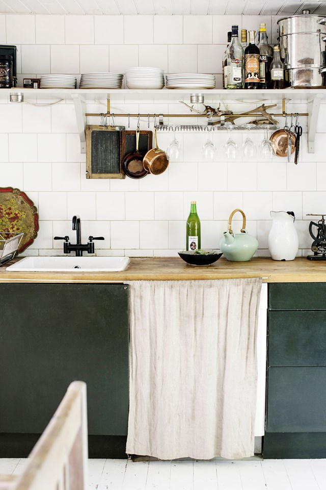 "One of the advantages to having a timber kitchen bench is that, while softer than stone or other man-made surfaces, it can be sanded back and re-finished to look brand new! But we think a little wear and tear adds to the rustic charm of the surface, on display in this [Swedish farmhouse](https://www.homestolove.com.au/a-rustic-farmhouse-filled-with-vintage-finds-6752|target=""_blank"")."
