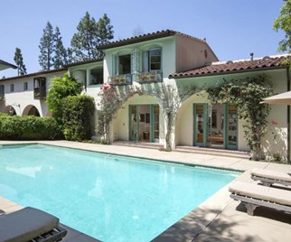 Outdoor pool at the rear of a Tuscan style mansion in Los Angeles
