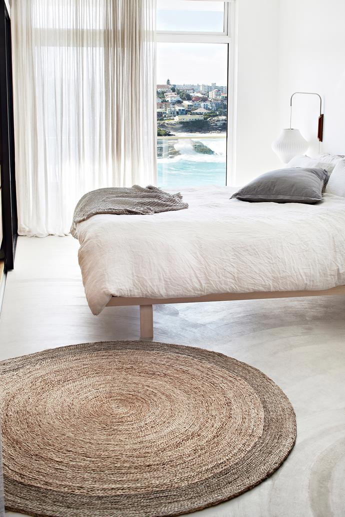 "This casually placed round jute rug adds texture and warmth with a relaxed coastal vibe. Flower Weave 'Zinnia' rug, $555, [Armadillo & Co.](https://armadillo-co.com/product/flower-weave-zinnia/|target=""_blank""