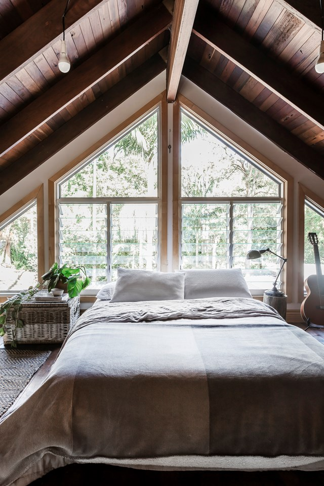 "A loft-like bedroom overlooking the rainforest is the ultimate parent's retreat in this [cedar and steel home in Currumbin Valley](https://www.homestolove.com.au/newly-built-cedar-and-steel-home-in-the-currumbin-valley-6764|target=""_blank""). Photo: Maree Homer / *Australian House & Garden*"