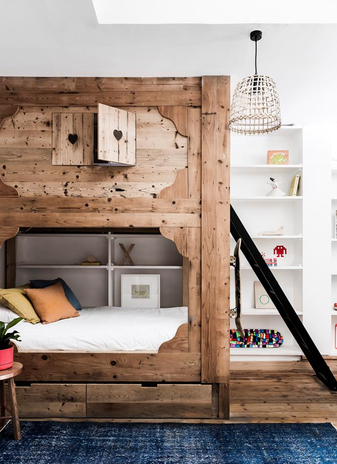 The boys' bunk bed was inspired by a trip to Switzerland, where the family visited many old barns. A third bed is hidden in the bottom drawer.