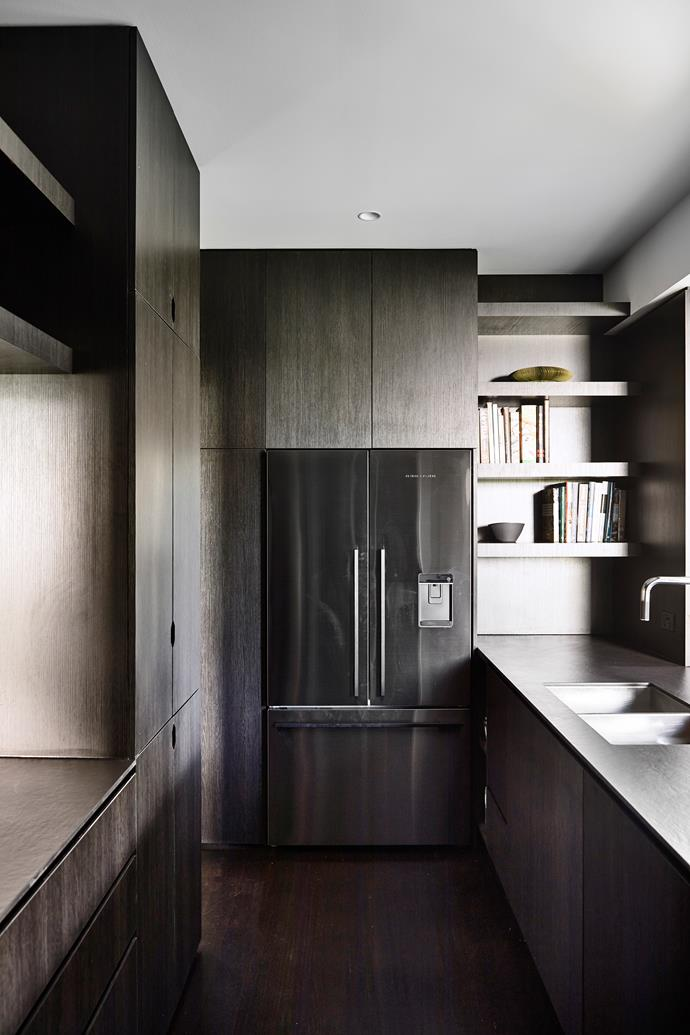 MDF joinery in Black Wenge Ravine blends seamlessly with the stainless steel kitchen appliances.